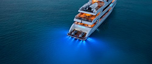Superyacht in calm waters showing blue LED